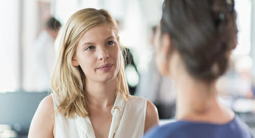 unhappy woman in office meeting